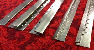 CLICK HERE FOR LARGER IMAGE OF HIG QUALITY BRUSHED CHROME CARPET TRIMS